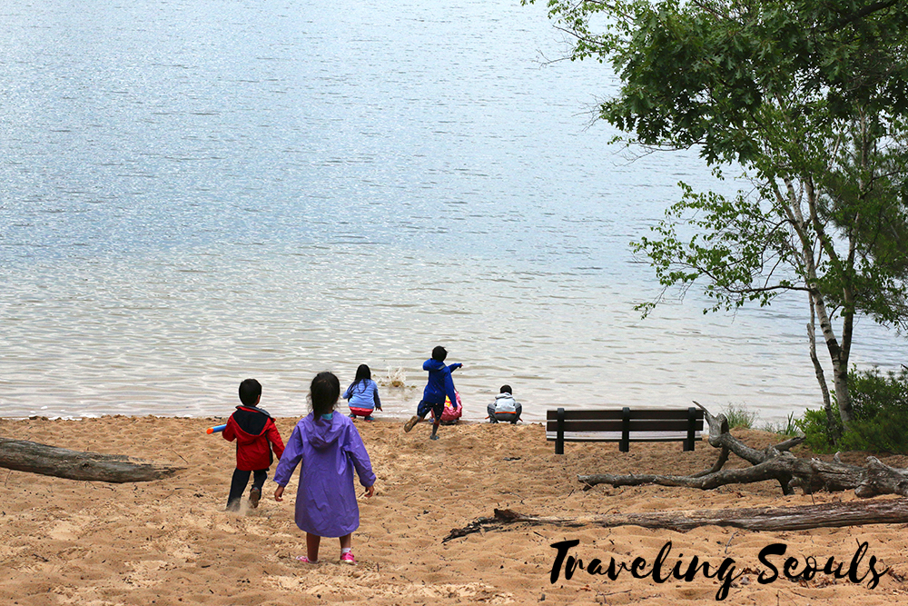 playing by lake skipping stones camping ludington state park michigan